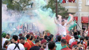 Portuguese soccer fan holding colored powders