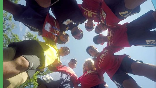 Ironbound Soccer Club in a group huddle
